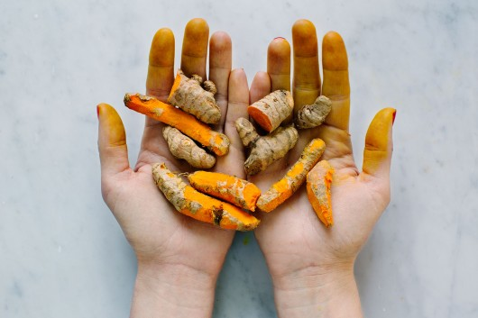 Raw turmeric root from the book Food Pharmacy with photography by food photographer Ulrika Ekblom.